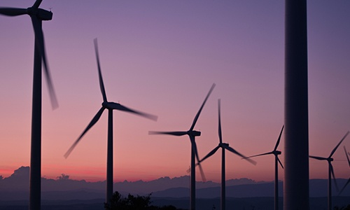 wind turbines with sunset